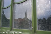 Church mirroring in the window of the Palmenhaus